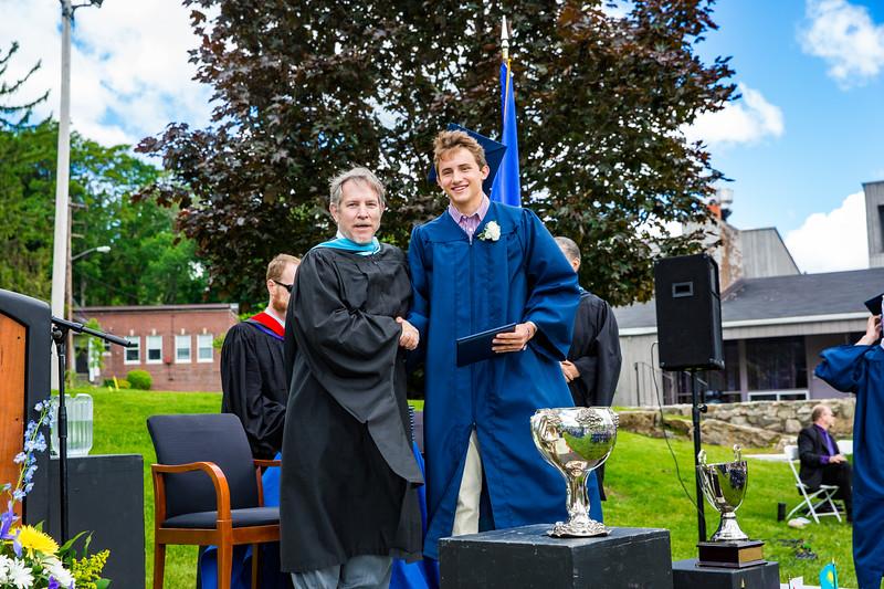Headmaster Lamb congratulates Dennis Richard McMahon IV