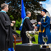 Michele DeFreece awards Sebastian Zucker with his diploma as Headmaster Lamb looks on