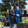Headmaster Lamb congratulates Garret Girardin