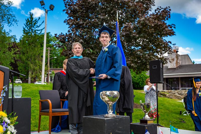 Headmaster Lamb congratulates Andrew Byrne on receiving his diploma