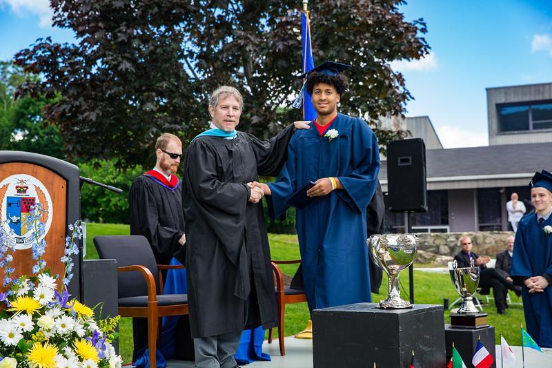 Headmaster Lamb congratulates Jose Figueroa on receiving his diploma