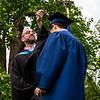 Mr. Lewis flips the tassel of graduate Pengxiang Zhou