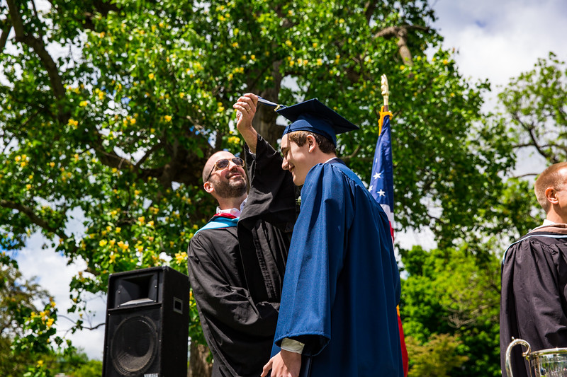 Mr. Lewis flips the tassel of Michael Roper