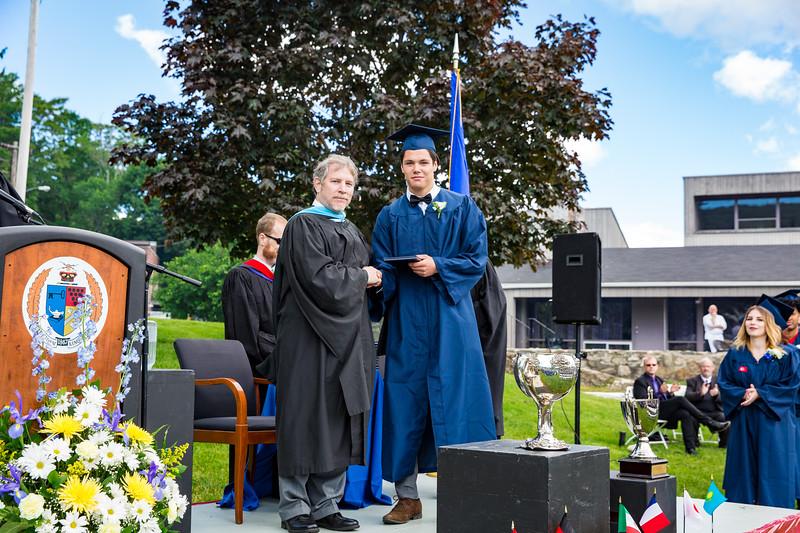 Headmaster Lamb congratulates Alex Conjic on receiving his diploma