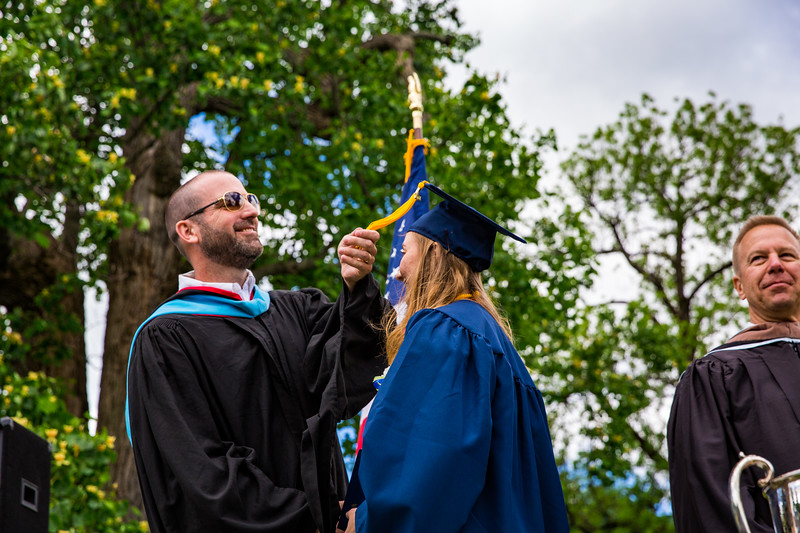 Mr. Lewis flips the tassel of Catherine Pomeroy
