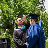 Mr. Lewis flips the tassel of Stephen Scheider