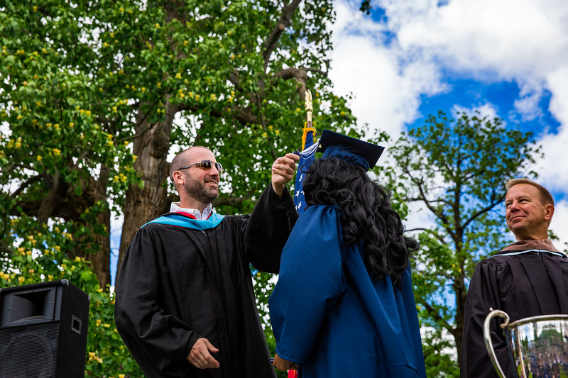 Mr. Lewis flips the tassel of Ashira Mayers