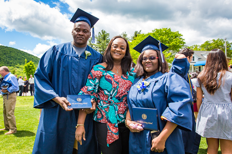 Graduates Gabriella and Christian Quartey posing with their proud mother on graduation day.