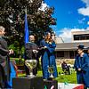 Michele DeFreece awards Sara Smith her diploma