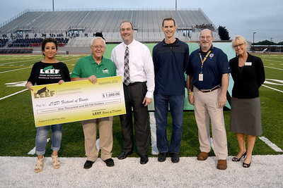 The Leander ISD Educational Excellence Foundation (LEEF) supports the annual Festival of Bands event with a $1,000 check.