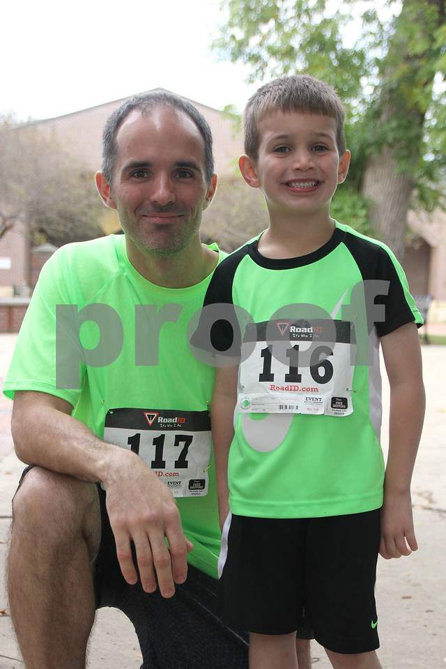 The 2016 Applefest Run took place at the city square by the Fort Dodge Library on Sunday, September 25, 2016. Along with participants that were running in the event there were refreshments available for runners after their run, and a few games for the kids complete with prizes. Seen left to right is: Jeff Cibert  and Ethan Cibert, a couple of the runners in the day's event.