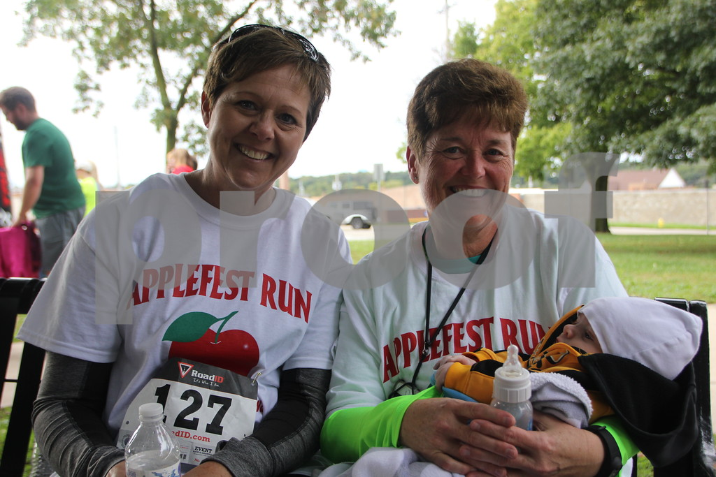 The 2016 Applefest Run took place at the city square by the Fort Dodge Library on Sunday, September 25, 2016. Along with participants that were running in the event there were refreshments available for runners after their run, and a few games for the kids complete with prizes. Seen left to right is: Diane Frerk, Jody Lyon, Wiley Frerk (baby) at the day's event.