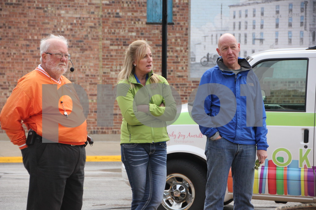 The 2016 Applefest Run took place at the city square by the Fort Dodge Library on Sunday, September 25, 2016. Along with participants that were running in the event there were refreshments available for runners after their run, and a few games for the kids complete with prizes. Shown here (left to right) is: Charles Walker, Dawn Larson,  and Troy Martens who were on hand to help with the event.