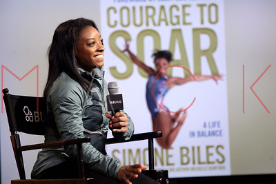 """NEW YORK, NY - NOVEMBER 16:  Simone Biles visits AOL Build Series to discuss her new book """"Courage to Soar"""" at AOL HQ on November 16, 2016 in New York City."""