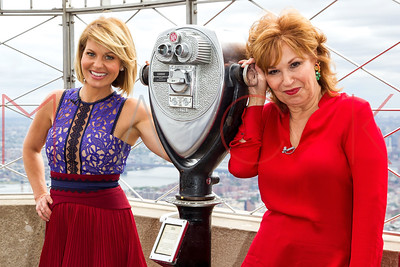 """NEW YORK, NY - SEPTEMBER 06:  Candace Cameron and Joy Behar, Co-Hosts of """"The Vew"""" light the Empire State Building in the show's colors of blue, teal and orange to celebrate The View's historic 20th season premiere at The Empire State Building on Septem"""