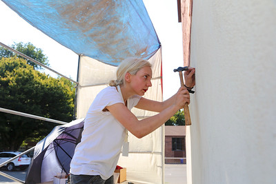 Alicia Palenyy starts her mural on a back wall at the E. Claire Raley Studios for the Performing Arts in Midtown.