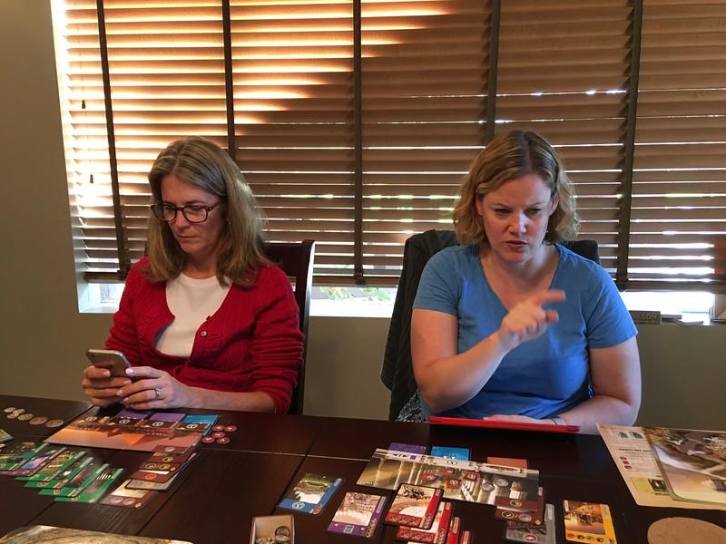 Barbara and Julie playing 7 Wonders