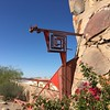 Taliesin West tour: Frank Lloyd Wright Home. This symbol was found on the site as a petroglyph and Wright thought it was hands clasping in friendship