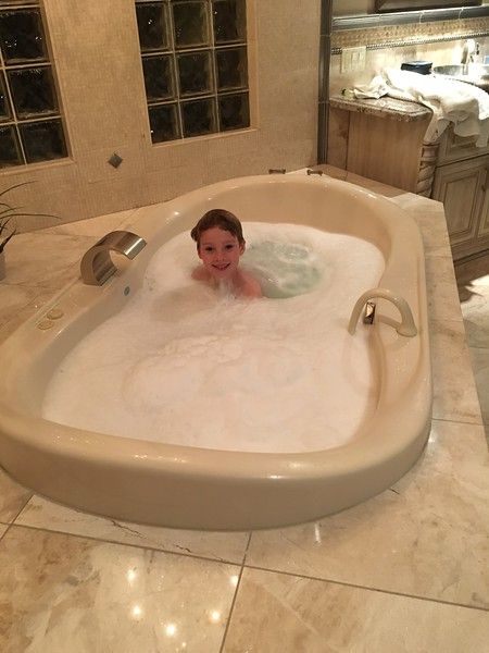 Peter enjoying the large deep Jacuzzi tub
