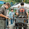 Nicholas Kapitulik works during the blacksmith competition at the Artsmith Festival on Saturday afternoon at Riverfront Park. SENTINEL & ENTERPRISE / Ashley Green