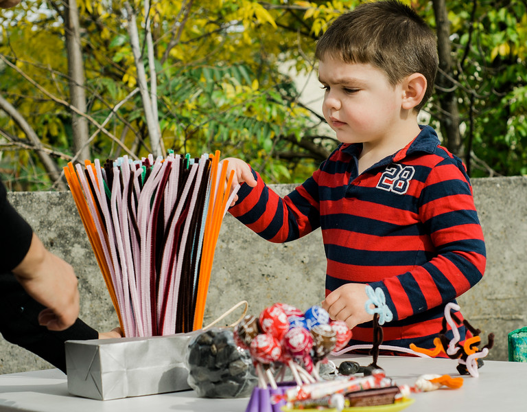 Dax Cote, 3, works on arts and crafts sponsored by the Fitchburg Public Library at the Artsmith Festival on Saturday afternoon at Riverfront Park. SENTINEL & ENTERPRISE / Ashley Green