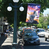 Auction Napa Valley flags proudly flying downtown St. Helena.<br /> <br /> Photo by Tony Albright for Napa Valley Vintners