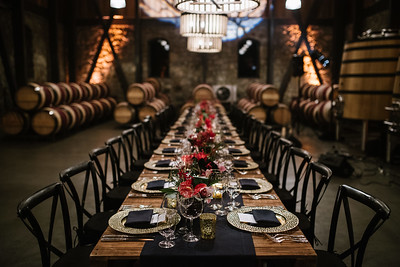 The table setting inside the barrel room at Alejandro Bulgheroni Estate.   Photo by Bob McClenahan for the Napa Valley Vintners