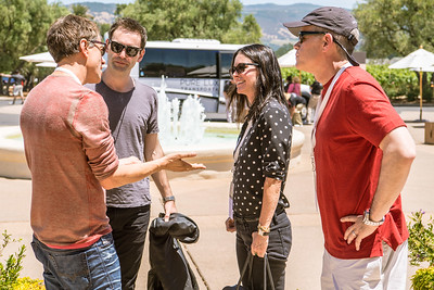 Courtney Cox and Johnny McDaid speak with Augustin Huneeus and David Duncan.   Photo by Bob McClenahan for the Napa Valley Vintners