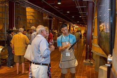 Volunteers aid bidders at the Barrel Auction. Robert Mondavi Winery  Briana Marie Photography for Napa Valley Vintners