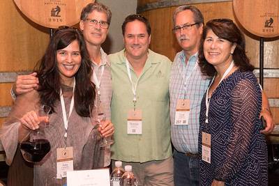 The Chappellets and Philip Titus pour their wine at the barrel auction at Robert Mondavi.   Photo by Bob McClenahan for the Napa Valley Vintners