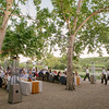 High bidders and vintners enjoying dinner service at Quintessa Winery event.<br /> <br /> Briana Marie Photography for Napa Valley Vintners