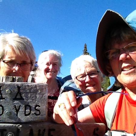 This was our fifth try taking a selfie with all four of us and the Trout Lake sign.  Believe it or not, this one was the best of the lot.  We kept saying we needed our grandchildren to coach.