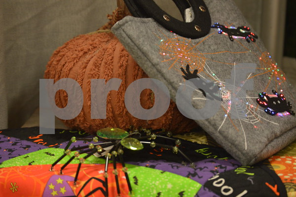 Halloween display toppers by Cindy Kaufman and Carol Heatherington were laid out.