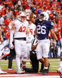 Penn State Nittany Lions running back Saquon Barkley (26) celebrates his touchdown during the second half of the Wisconsin Badgers against the Penn State Nittnay Lions for the Big Ten football championship at Lucas Oil Stadium in Indianapolis, Ind., Sunday, Dec. 4, 2016. Penn State won the game 38-31. (Photo by Sam Riche)