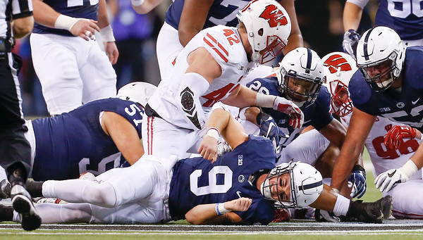Penn State Nittany Lions quarterback Trace McSorley (9) is hit hard and fumbled the ball during the first half of the Wisconsin Badgers against the Penn State Nittnay Lions for the Big Ten football championship at Lucas Oil Stadium in Indianapolis, Ind., Saturday, Dec. 3, 2016. (Photo by Sam Riche)