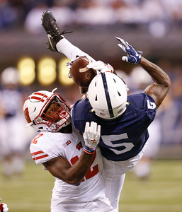 Wisconsin Badgers cornerback Natrell Jamerson (12) can't stop this catch by Penn State Nittany Lions wide receiver DaeSean Hamilton (5) during the second half of the Wisconsin Badgers against the Penn State Nittnay Lions for the Big Ten football championship at Lucas Oil Stadium in Indianapolis, Ind., Sunday, Dec. 4, 2016. Penn State won the game 38-31. (Photo by Sam Riche)