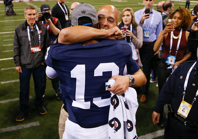 Penn State Nittany Lions head coach James Franklin hugs Penn State Nittany Lions wide receiver Saeed Blacknall (13) after the game during the second half of the Wisconsin Badgers against the Penn State Nittnay Lions for the Big Ten football championship at Lucas Oil Stadium in Indianapolis, Ind., Sunday, Dec. 4, 2016. Penn State won the game 38-31. (Photo by Sam Riche)