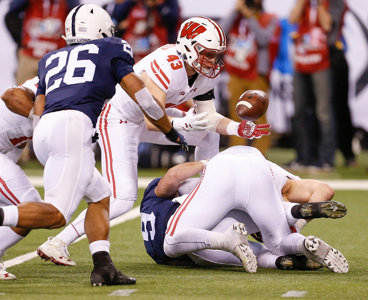 Wisconsin Badgers linebacker Ryan Connelly (43) scoops up this fumbled ball and runs for a touchdown during the first half of the Wisconsin Badgers against the Penn State Nittnay Lions for the Big Ten football championship at Lucas Oil Stadium in Indianapolis, Ind., Saturday, Dec. 3, 2016. (Photo by Sam Riche)