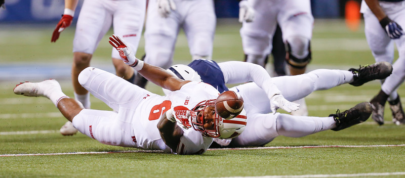 Wisconsin Badgers running back Corey Clement (6) fumbled the ball but Wisconsin retained possession during the first half of the Wisconsin Badgers against the Penn State Nittnay Lions for the Big Ten football championship at Lucas Oil Stadium in Indianapolis, Ind., Saturday, Dec. 3, 2016. (Photo by Sam Riche)