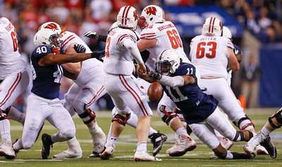 Penn State Nittany Lions linebacker Brandon Bell (11) strips the ball from Wisconsin Badgers quarterback Bart Houston (13) during the second half of the Wisconsin Badgers against the Penn State Nittnay Lions for the Big Ten football championship at Lucas Oil Stadium in Indianapolis, Ind., Sunday, Dec. 4, 2016. Penn State won the game 38-31. (Photo by Sam Riche)