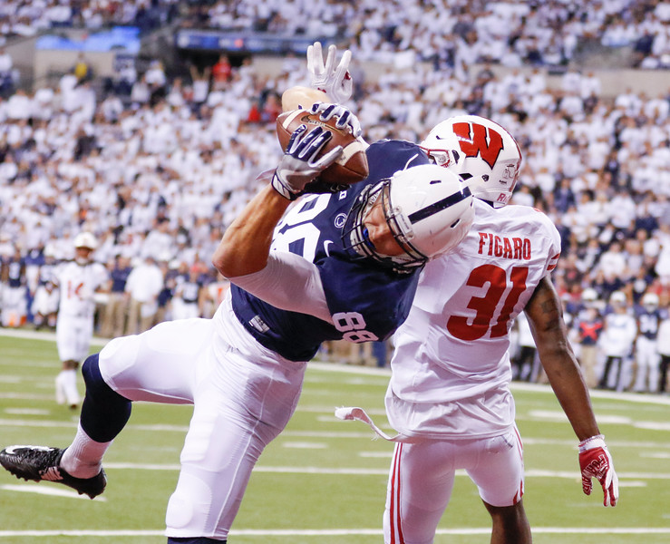 Penn State Nittany Lions tight end Mike Gesicki (88) hauls in a touchdown against Wisconsin Badgers safety Lubern Figaro (31) during the first half of the Wisconsin Badgers against the Penn State Nittnay Lions for the Big Ten football championship at Lucas Oil Stadium in Indianapolis, Ind., Saturday, Dec. 3, 2016. (Photo by Sam Riche)