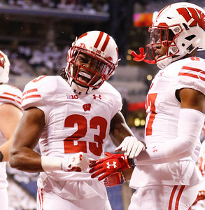 Wisconsin Badgers running back Dare Ogunbowale (23) celebrates his touchdown during the first half of the Wisconsin Badgers against the Penn State Nittnay Lions for the Big Ten football championship at Lucas Oil Stadium in Indianapolis, Ind., Saturday, Dec. 3, 2016. (Photo by Sam Riche)