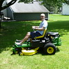 Lawn mower riding in the back yard.
