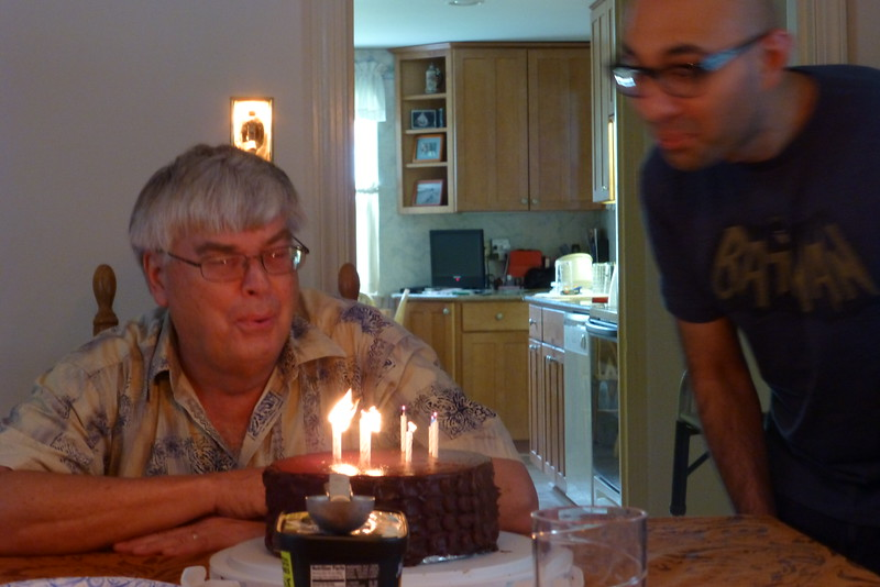 Blowing out of the candles by the birthday boys,  (Poor Val has to make his own Birthday cake.)
