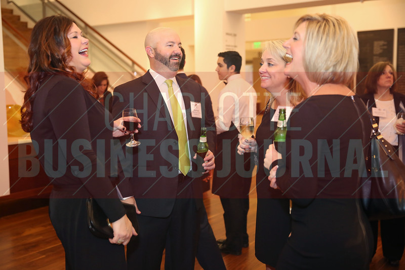 Performance Staffing Solutions, Inc. coworkers joke around at the CBJ Book of Lists Gala held at the Foundation For The Carolinas on Jan. 28.