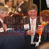 Tom Skains, CEO Piedmont Natural Gas, talks with friends and family at the CBJ Book of Lists Gala held at the Foundation For The Carolinas on Jan. 28.