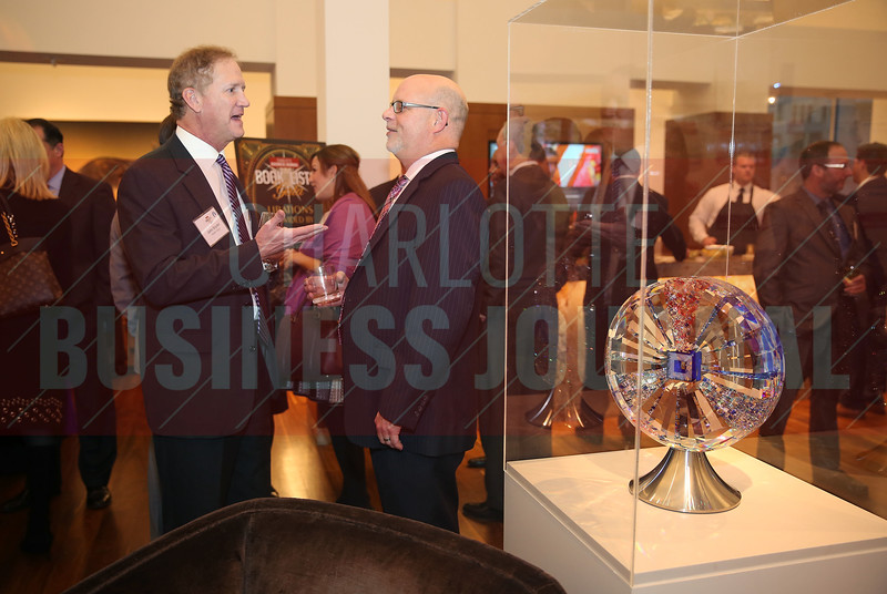 John Snyder, Wells Fargo, enjoys conversation with a coworker at the CBJ Book of Lists Gala held at the Foundation For The Carolinas on Jan. 28.