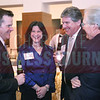 Kevin Pitts, CBJ Publisher, Sherry Skains, and Tom Skains, CEO of Piedmont Natural Gas, joke around at the CBJ Book of Lists Gala held at the Foundation For The Carolinas on Jan. 28.