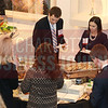 Bank of America employees enjoy appetizers at the CBJ Book of Lists Gala held at the Foundation For The Carolinas on Jan. 28.