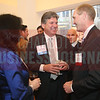 Tom Skains, CEO of Piedmont Natural Gas, jokes around with friends and family at the CBJ Book of Lists Gala held at the Foundation For The Carolinas on Jan. 28.